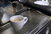 Espresso pouring into a cup — Stock Photo