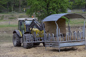 Tractor driven hay feeder for cattle — Stock Photo