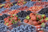 Ripe berries in a plastic container  — Stock Photo