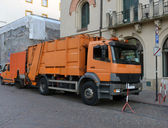 Garbage truck in the street cities — Stock Photo