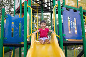 Girl playing on the slide — Stock Photo