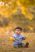 Asian 10-month old boy having fun outdoors — Stock Photo