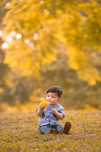Asian 10-month old boy having fun outdoors — Stock fotografie
