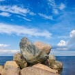 Stone mound on the lake - Stock Photo