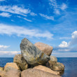 Stone mound on the lake — Stock Photo