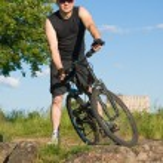 Young man on a mountain bike — Stock Photo