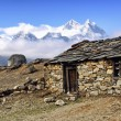 Stock Photo: Old stone shed in mountains