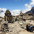 Stock Photo: Porter on halt. Nepal, Himalayas