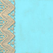 Turquoise background with lace trim — Stock Photo