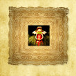 Stock Photo: Greeting card,funny angel in old frame