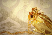 Card, sack with gold jewelry — Stock Photo