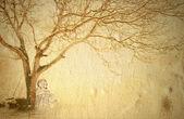 Buddha meditating under a tree — Stock Photo
