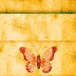 Royalty-Free Stock Photo: Golden butterfly  on grunge background