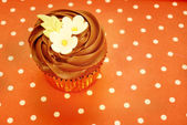 Chocolate cupcake decorated with flowers — Photo