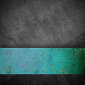 Gray grunge background and turquoise ribbon — Stock Photo