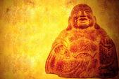 Smiling buddha sitting parchment background — Stock Photo