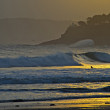 Surfer catching waves at dawn in Santander — Stock Photo