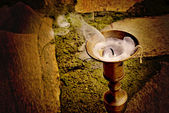 Unlit candle in candlestick antique bronze — Stock Photo