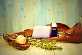 Rustic background herbal essential oils — Stockfoto