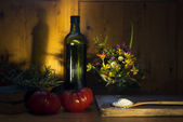 Still life virgin olive oil flour rosemary  and tomatoes — Stock Photo