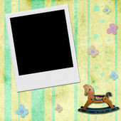 Instant photo frame in chid background  — Stock Photo