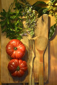 Ripe tomatoes, parsley bay leaf and rosemary vintage — Stock Photo