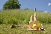 Woman relaxing on a green meadow  — Stock Photo