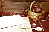 Blank recipe notebook background and basket with fruit — Stock Photo