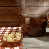 Stew potatoes and fish in clay plate ration — Stock Photo