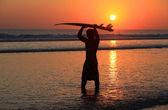 Surfer on sunset — Stock Photo