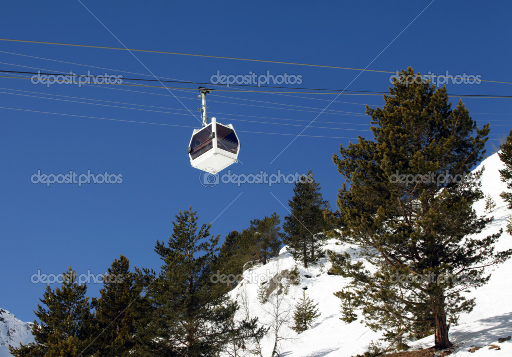 Cabin lift of a ski resort on a background of the dark blue sky — Stock Photo #12773740