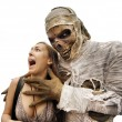 Mummies and young woman — Stockfoto
