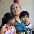 Indonesian grandmother with the grandsons — Stock Photo