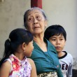 Indonesian grandmother with the grandsons - Stock Photo