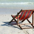 Chaise lounge on a beach — Stock Photo