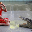 Crocodile show in Thailand - Stock Photo