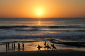 Surfers on sunset — Stock Photo