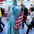 Stock Photo: Artist imitating statue of liberty