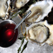 Opened oysters on ice — Stock Photo #35069221