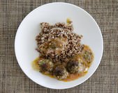 Buckwheat with small meat balls — Stock Photo
