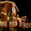 Decorated house with christmas lights — Stock Photo #35810777