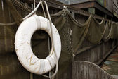 Fishnets and lifebuoy — Stock Photo
