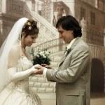 Groom puts wedding ring — Stock Photo
