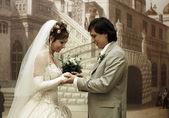 Groom puts wedding ring — Photo