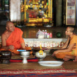 Monks in temple — Stock Photo