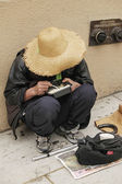 Chinese homeless woman — Stock Photo