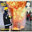 UNITED KINGDOM - CIRCA 2009: a stamp printed in UK shows a firefighter putting out a fire, fire safety, circa 2009 — Стоковое фото #11969797