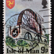 Stock Photo: Stamp printed in Isle Of Mann shows Laxey Wheel is large waterwheel built in village of Laxey