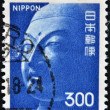 Stock Photo: A stamp printed in Japan, shows the head of the Buddha, the Temple Yamada, Asuka
