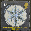 A stamp printed in Great Britain shows the Snowflake, royal microscopical society - Stock Photo
